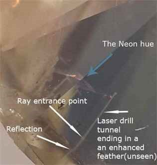 The white tunnel of the laser drill to the enhanced feather, not seen